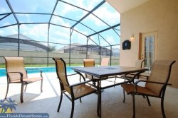 Spacious Pool Deck Includes Covered Lanai, Table, Chairs and Loungers
