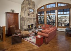 A beautiful and spacious vacation home rental in Arrowhead, Colorado with scenic views of the Eagle River wetlands.