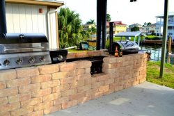 Great outdoor entertaining area with both gas and charcoal grills available.
