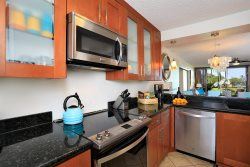 Kitchen is modern and fully-equipped