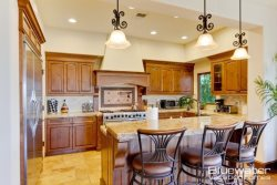 Slab granite counters, European hardwood cabinetry  Viking Appliances