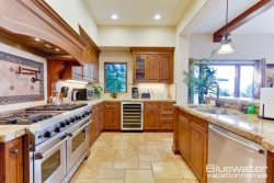 Gourmet Kitchen with professional grade appliances and wine cooler
