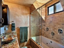 Walk-in Shower with Natural Stone Sink and Counter