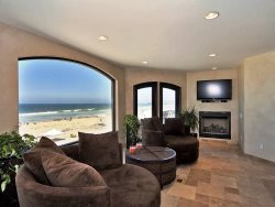 Ocean View Living Room with Fireplace and HDTV