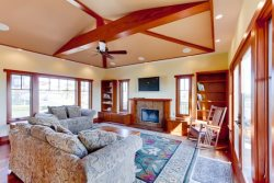 Vaulted ceiling design opens up the second living space with an HDTV and patio access