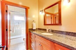 Full bath with granite counters and separated shower\/tub combo