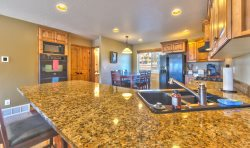 Gourmet Kitchen with Granite Counters  Alder Cabinets