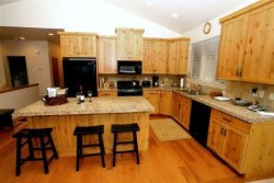 Gourmet Kitchen with Granite Counters and Knotty Alder Cabinets