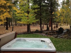 Enjoy this spacious 3 bedroom Sisters vacation rental on one private acre with peaceful backyard featuring a private hot tub and beautiful water feature.