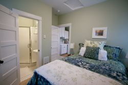 carriage house bedroom with double bed and bath