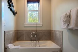Main floor - heated and jetted soaking tub, a large walk-in shower