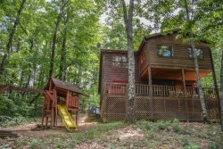 SERENITY NOW LODGE- 3 BEDROOM, 2 BATH PRIVATE CABIN WITH BEAUTIFUL MTN VIEW! HIKING DISTANCE TO WATERFALL, SLEEPS 10, WIFI, HOT TUB, PET FRIENDLY, WII, FOOSBALL/AIR HOCKEY COMBO, STACKED STONE FIREPLACE, OUTDOOR FIRE PIT, STARTING AT $135/NIGHT!