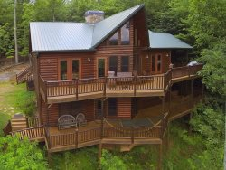 PEACEFUL VIEW LODGE- BREATHTAKING MTN VIEWS,4 BR/4.5 BA,HOT TUB, POOL TABLE, PING PONG, FOOSBALL, AIR HOCKEY, 6 FLAT SCREEN TV`S, GAS LOG FIREPLACES, WIFI, GAS GRILL, SLEEPS 13, STARTING AT $250/NIGHT!