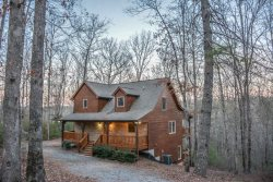 APPALACHIAN PROMISE- 3BR/3.5BA- SECLUDED CABIN SLEEPS 8, MOVIE ROOM, WIFI, POOL TABLE, FOOSBALL, SATELLITE TV, GAS LOG FIREPLACE, HOT TUB ON COVERED PORCH, GAS GRILL, AND A FIRE PIT! STARTING AT  $150 A NIGHT!
