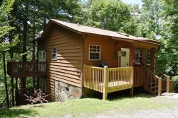 ARAPAHO- 2BR/1BA- ADORABLE WOODED CABIN, FLAT SCREEN TV WITH SATELLITE, GAS LOG FIREPLACE, WIFI, KING BED, WASHER/DRYER, GAS GRILL, AND ONLY 5 MINUTES FROM TOWN! STARTING AT $79 A NIGHT!