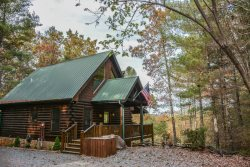 BUCKSKIN BLUFF-3BR/3BA- CABIN WITH A BEAUTIFUL MOUNTAIN VIEW THAT SLEEPS 6, 3 KING SUITES, PET FRIENDLY, FLAT SCREEN TV`S IN EVERY ROOM, WIFI, HOT TUB, POOL TABLE, 2 JETTED TUBS, GAS GRILL, AND A WOOD BURNING FIREPLACE!STARTING AT $180 A NIGHT!