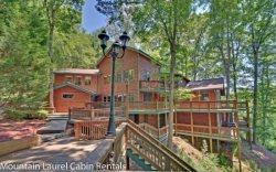 JORDAN LODGE- BEAUTIFUL 6BR/4BA CABIN WITH DOCK ON BEAR LAKE, BEAUTIFUL MOUNTAIN VIEWS, SLEEPS 18, INDOOR HOT TUB, GAME ROOM WITH POOL TABLE, FOOSE BALL, DARTS AND XBOX, GAS GRILL, AND A WOOD BURNING FIREPLACE! STARTING AT $400 A NIGHT!