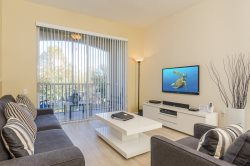 Seconds to Pool | 2nd Floor Condo with Wood Floors and Granite Countertops
