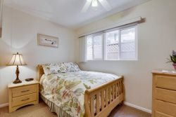 Double bed in the second bedroom with quality linens