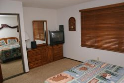 Mammoth Lakes Condo Rental Woodlands 36 - Master Bedroom with a TV