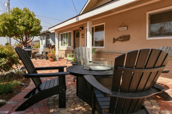 Enjoy the patio area with comfortable seating and a Weber barbecue grill.
