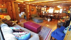 Bear Run Cabin - Walk to Main Street - Rustic Cabin - WiFi, Cable - Washer/Dryer - Wood Burning Fireplace - Secluded Setting - Large Yard Featuring Outdoor Fire pit with seating area
