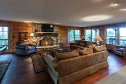 Great Room with a wood burning fireplace and pool table