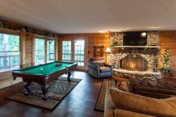 Great Room with a wood burning fireplace and game table