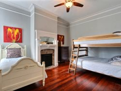 Downstairs bedroom with queen size bed and flatscreen TV