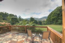 Upscale Family-style Mountain Log Ranch on large, level yard with panoramic mountain and valley views!