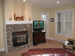 Hawks Peak Living Room with gas stone fireplace and nice flat screen TV