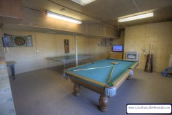 Top of The World Game Room with Full Sized Pool Table separate Ping Pong Table and Darts
