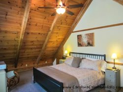 Trailhead Cabin King Bedroom on Loft Level with Vaulted Heavy Timber Ceiling