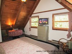 Trailhead Cabin King Bedroom with large flat screen TV and Valuted Ceiling