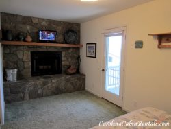 Mountain Sunrise Wood Burning Stone Fireplace in Master Bedroom Suite