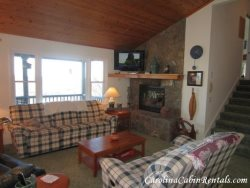 Mountain Sunrise Living Room with Stone Wood Burning Fireplace, Flat Screen TV and VIEWS