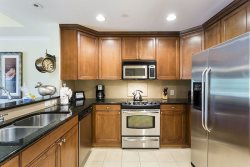 Fully equipped kitchen with granite counter tops and stainless steel applainces