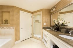 En suite bathroom with large walk in shower and garden tub