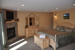 The Master Suite on the Lower Level with King Bed, Private Bath, and Access to the Hot Tub