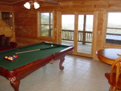 Enjoy a Game of Pool with a Mountain View in the Downstairs Game Room