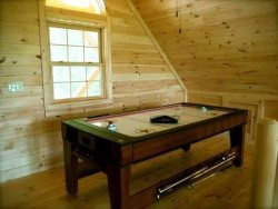 The Combination Pool And Air Hockey Table in the Loft