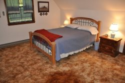 The Upstairs Bedroom features a Queen Bed Plus a TV and DVD Player