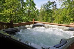 Enjoy Revitalizing Mountain Aire from the Covered Porch or the Hot Tub