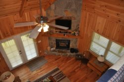 Glowing with Mountain Ambiance, the Living Room has Satellite TV and a Gas Fireplace