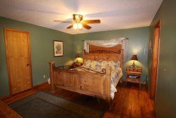 Upstairs Master Bedroom With King Size Bed And Full Bathroom - Lake LBJ Lodging