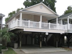 V6 Relax in the rocking chairs on the covered porch of this Ocean Lakes vacation home on a quiet street. Pets welcome. WIFI