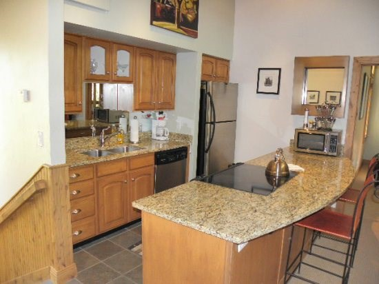 Fully Equipped Kitchen, Opens into Living Room