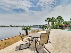 Beautiful Lake Front Home with Gulf Views Located in `Destiny West` Steps to the Beach Featuring A Private Pool!