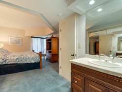 Master Bedroom at 107 Barrington Arms features a King bed and has access to the balcony
