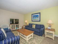 Living Room at 1704 Bluff Villa has a large flat panel TV and DVD player